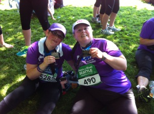Duana and me, holding our finishing medals - tired, but happy